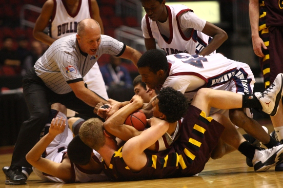 Salpointe Catholic and Sierra Linda players pile on top of each other while battling for a loose ball during the Division II boy's basketball quarterfinals at Jobing.com Arena in Glendale Aaron Lavinsky/The Arizona Republic