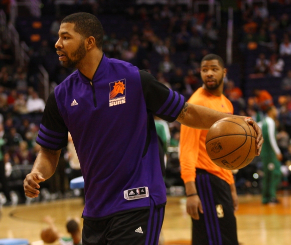 Suns forward Markieff Morris practices as his brother Marcus looks on behind him on Friday, Feb. 22, 2013 at US Airways Center. Aaron Lavinsky/The Arizona Republic