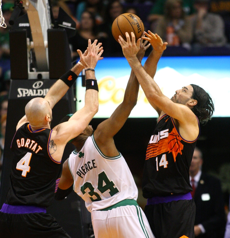 Suns center Marcin Gortat (4) and Suns forward Luis Scola (14) battle Celtics forward Paul Pierce (34) for a loose ball in the third quarter on Friday, Feb. 22, 2013 at US Airways Center. Aaron Lavinsky/The Arizona Republic