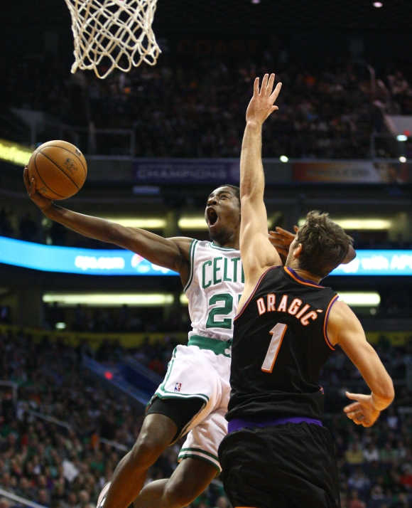 Celtics guard Jordan Crawford attempts a layup as he is guarded by Suns point guard Goran Dragic (1) in the second half on Friday, Feb. 22, 2013 at US Airways Center. Aaron Lavinsky/The Arizona Republic