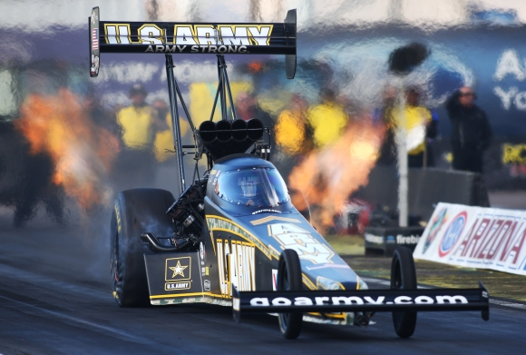 Top Fuel champion Tony Schumacher takes off from the starting line during NHRA Arizona Nationals quarterfinals on  Sunday, Feb. 24, 2013 at Firebird International Raceway. Aaron Lavinsky/The Arizona Republic