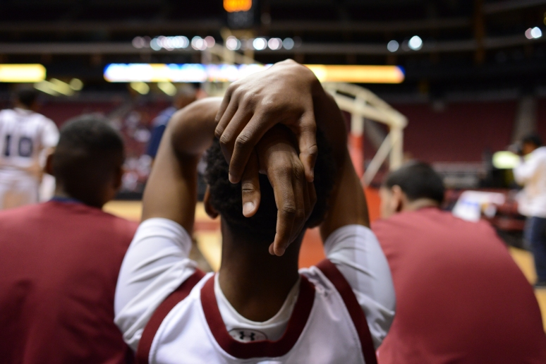 Sierra Linda junior Darius Amos holds his head with disappointment after being defeated by Salpointe Catholic  during the Division II boy's basketball quarterfinals at Jobing.com Arena in Glendale Aaron Lavinsky/The Arizona Republic