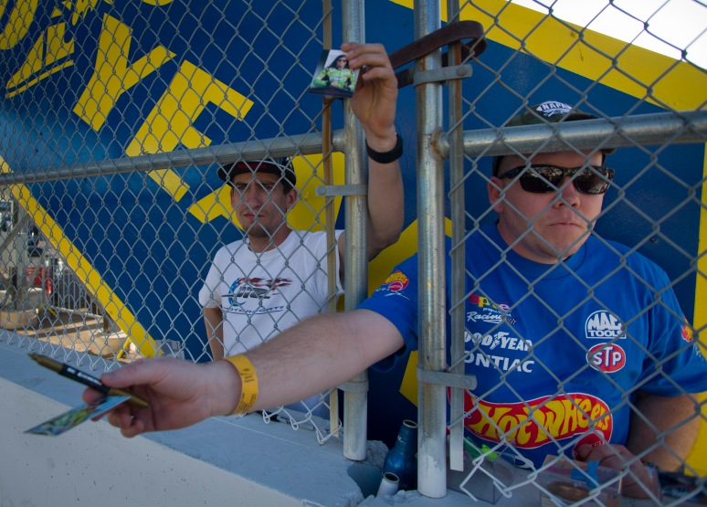 Brothers Jonathan (right) and Andrew Hayood attempt to get an autograph by Danica Patrick on Friday, March 1, 2013 at Phoenix International Raceway. Aaron Lavinsky/The Arizona Republic