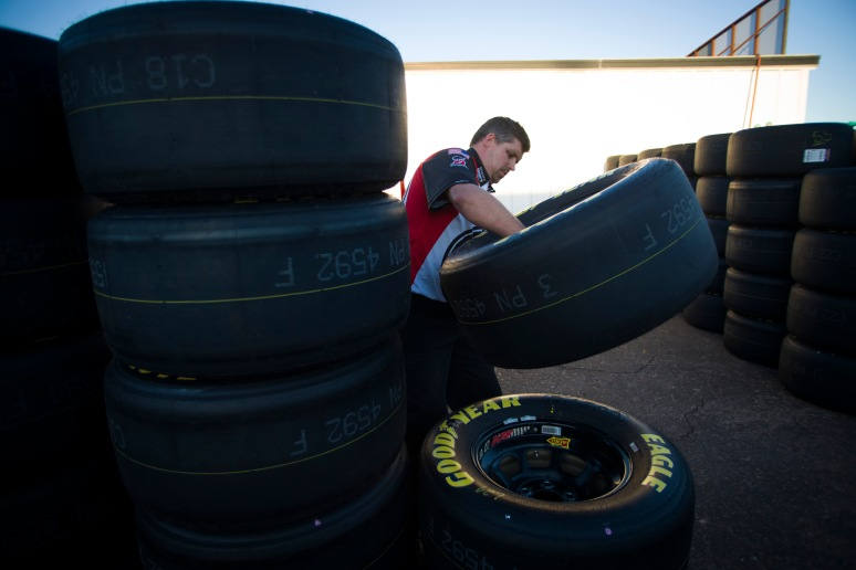 Andy Flynn, of team Jimmy John's Chevrolet, stacks tires after the Sprint Cup Poll race on Friday, March 1, 2013 at Phoenix International Raceway. Aaron Lavinsky/The Arizona Republic