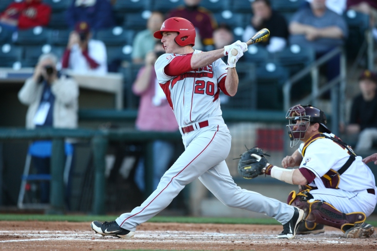 Arkansas infielder Matt Vinson follows through on a missed swing against ASU during the Coca-Cola Classic on Thursday, Feb. 28, 2013 at Surprise Stadium. Aaron Lavinsky/The Arizona Republic