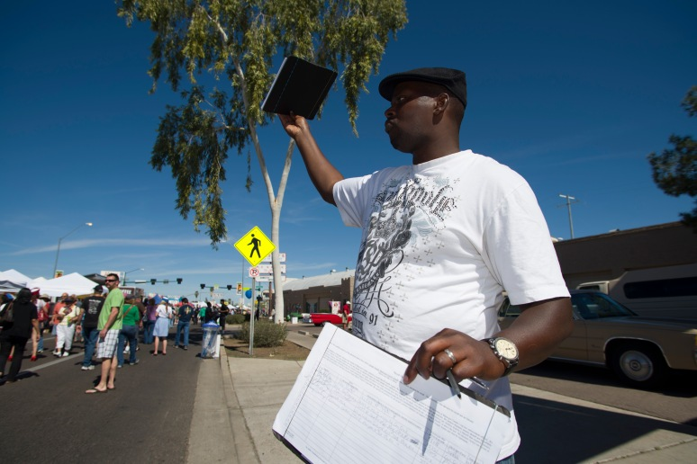 Abdullah Yaqiyn petitions for the recall of Maricopa Sheriff Joe Arpaio at the m7 Street Fair on 7th Avenue on March 2, 2013. Aaron Lavinsky/The Arizona Republic